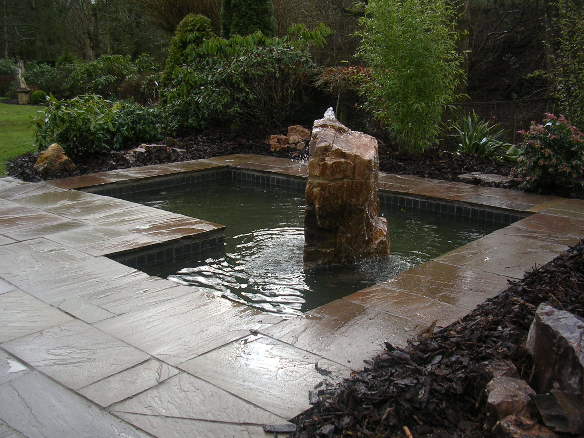 Bubble stone set within formal pond