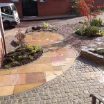 Sandstone paving with granite setts
